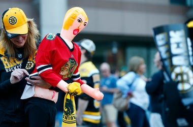 Jun 19, 2013; Boston, MA, USA; Boston Bruins fan Maryellen Cahill holds an inflatable doll wearing a Chicago Blackhawks jersey before game four of the 2013 Stanley Cup Final at TD Garden. Mandatory Credit: Greg M. Cooper-USA TODAY Sports