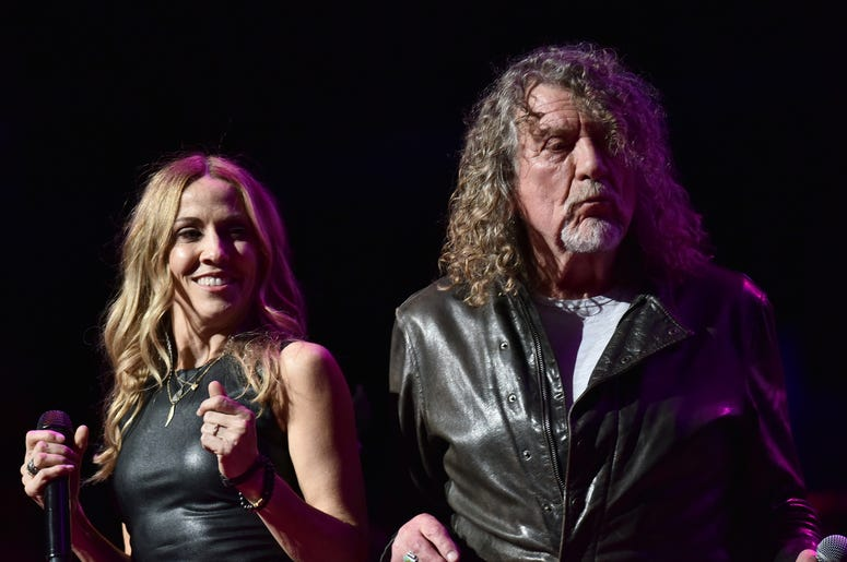 Musicians Sheryl Crow (l) and Robert Plant perform during the 3rd Annual LOVE ROCKS NYC concert at the Beacon Theatre in New York, NY, March 7, 2019.