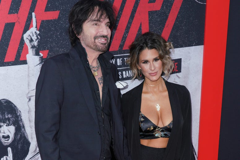 Tommy Lee and Brittany Furlan at Los Angeles Premiere Of Netflix's 'The Dirt' held at The ArcLight Hollywood - Cinerama Dome on March 18, 2019 in Hollywood, CA,