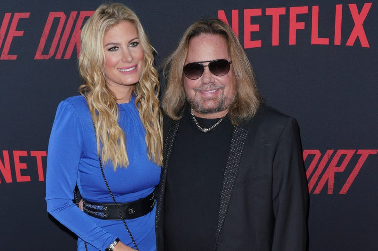 Rain Hannah and Vince Neil at Los Angeles Premiere Of Netflix's 'The Dirt' held at The ArcLight Hollywood - Cinerama Dome on March 18, 2019 in Hollywood, CA