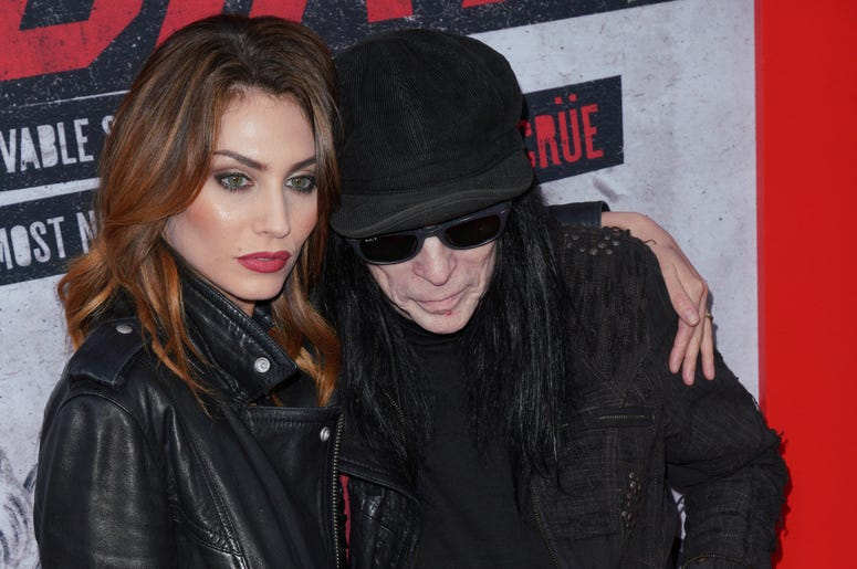 Fai McNasty and Mick Mars at Los Angeles Premiere Of Netflix's 'The Dirt' held at The ArcLight Hollywood - Cinerama Dome on March 18, 2019 in Hollywood, CA