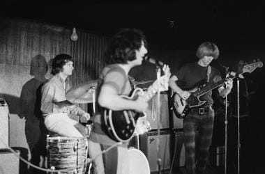 The Grateful Dead in concert, circa 1970. From left to right, drummer Bill Kreutzmann, lead singer Jerry Garcia and bassist Phil Lesh.