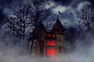 Creepy house with bats and red light from the windows