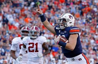 Bo Nix #10 of the Auburn Tigers reacts as he rushes for a touchdown against the Alabama Crimson Tide