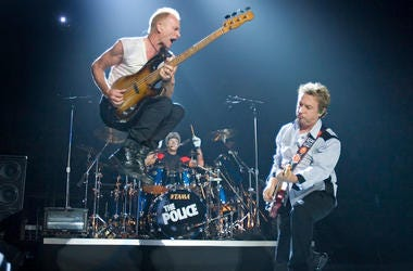 Lead singer Sting (L), lead guitarist Andy Summers (R) and drummer Stewart Copeland (C) of the band The Police perform onstage to open their world tour