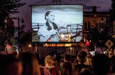 """Dorothy lights up the 40-foot screen in downtown Oconomowoc during the 75th anniversary screening of \""""The Wizard of Oz\"""" on Thursday, Aug. 7, 2014. Thousands of fans were on hand to view the movie which originally premiered on Aug. 12, 1939 at the Strand"""