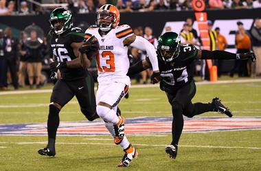 Cleveland Browns wide receiver Odell Beckham (13) gets past New York Jets cornerback Brian Poole (34) and linebacker Neville Hewitt (46) to score a 89 yard touchdown during the third quarter at MetLife Stadium.