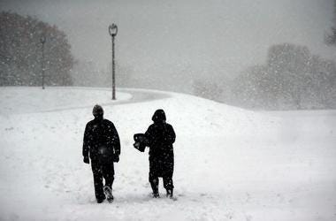 Alex Molnar, left, and his wife Barbara Lindquist walk through McKinley Marina to enjoy the first major snow storm of the season. While most may be dreading this unwelcome fall storm, It s a beautiful day, said Molnar. Mjs Wild Snow 1