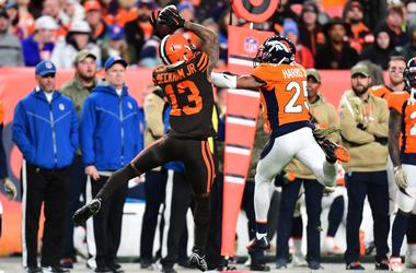 Cleveland Browns wide receiver Odell Beckham (13) pulls in a reception over Denver Broncos cornerback Chris Harris (25) in the second half at Empower Field at Mile High.
