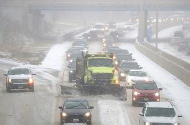 A Milwaukee County snow plow makes its way through traffic as it clears the snow from I-43 just north of West Green Tree Road in Glendale on Monday, Nov. 11, 2019. Xxx Tdl 009 Jpg Rac Usa Wi