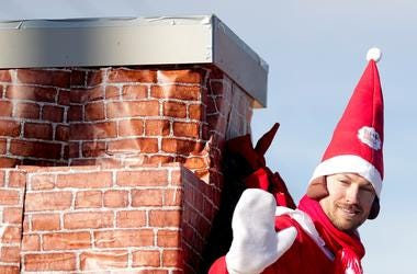 Elf on the Shelf enjoys a ride on his chimney during the 36th Annual Prevue Green Bay Holiday Parade along North Jefferson Street, West on Cherry Street and South on Washington Street in Green Bay, Wis. Ebony Cox/USA TODAY NETWORK-Wisconsin Gpgparade8590
