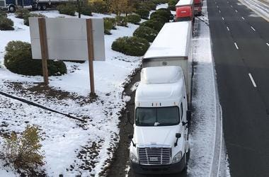 Truckers parked on the side of northbound I-5 because they say there s no room for them at the truck stops. Snow 2