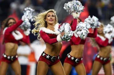 Dallas Cowboys cheerleaders perform in holiday outfits during halftime of the game against the Los Angeles Rams at AT&T Stadium.