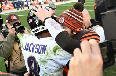 Cleveland Browns quarterback Baker Mayfield (6) and Baltimore Ravens quarterback Lamar Jackson (8) hug after the game at FirstEnergy Stadium.