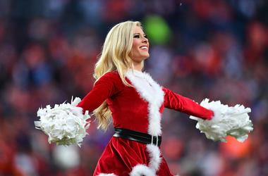 A Denver Broncos cheerleader performs in the second half against the Detroit Lions at Empower Field at Mile High.