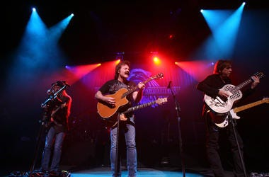 Tom Johnston, center, Patrick Simmons, left, and John McFee of the Doobie Brothers