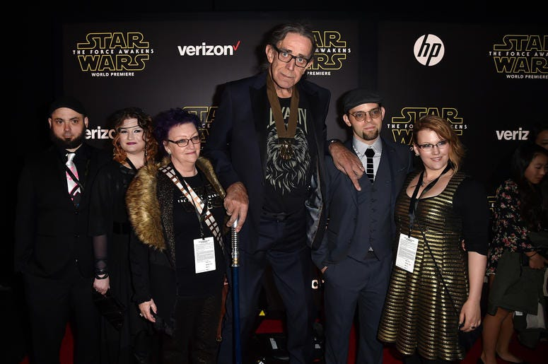 "Actor Peter Mayhew (C) and family attend the World Premiere of ""Star Wars: The Force Awakens"""