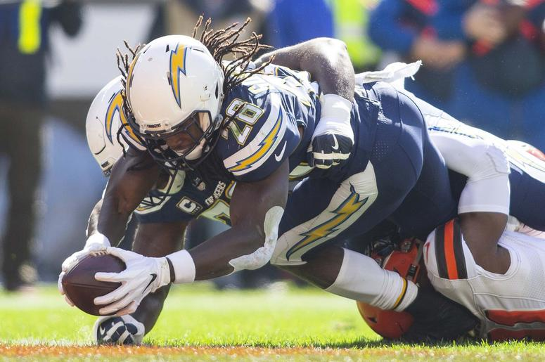 Los Angeles Chargers running back Melvin Gordon (28) dives into the end zone for a touchdown against the Cleveland Browns during the first quarter at FirstEnergy Stadium.