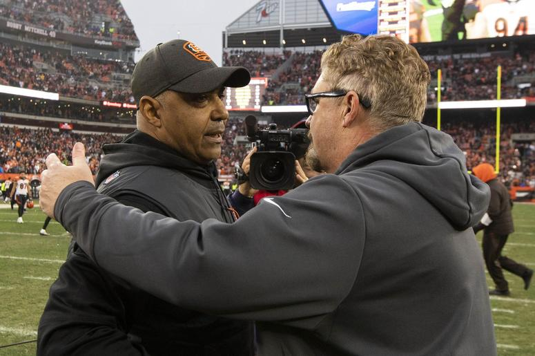Cincinnati Bengals head coach Marvin Lewis (left) congratulates Cleveland Browns head coach Gregg Williams on the win after the game at FirstEnergy Stadium.