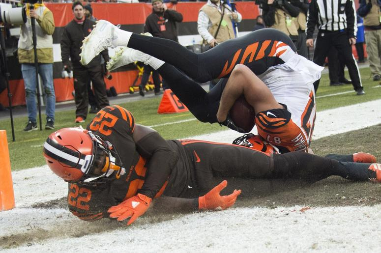 Cincinnati Bengals tight end C.J. Uzomah (87) comes down with a touchdown as Cleveland Browns free safety Jabrill Peppers (22) defends during the second half at FirstEnergy Stadium.