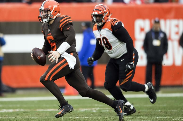 Cleveland Browns quarterback Baker Mayfield (6) scrambles as Cincinnati Bengals defensive end Christian Ringo (79) pursues during the second half at FirstEnergy Stadium.