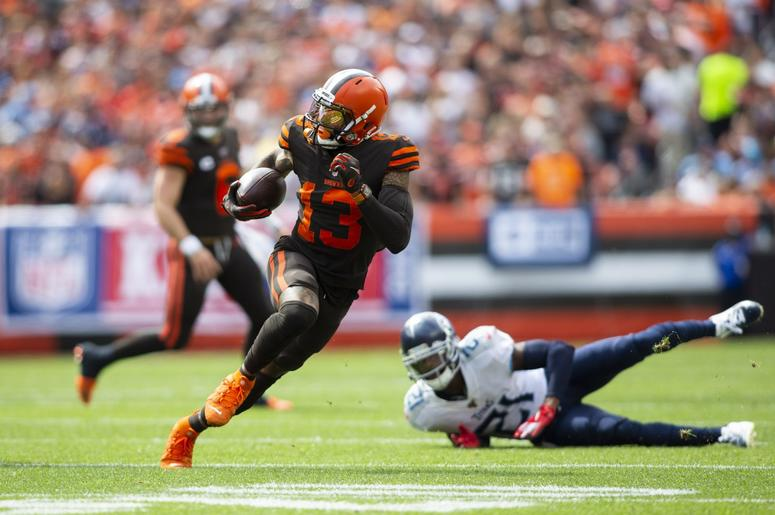 Cleveland Browns wide receiver Odell Beckham (13) runs the ball past Tennessee Titans cornerback Malcolm Butler (21) during the first quarter at FirstEnergy Stadium.