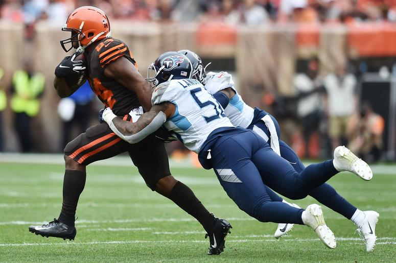 Tennessee Titans linebacker Harold Landry (58) and free safety Kevin Byard (31) chase down Cleveland Browns running back Nick Chubb (24) during the second half at FirstEnergy Stadium.