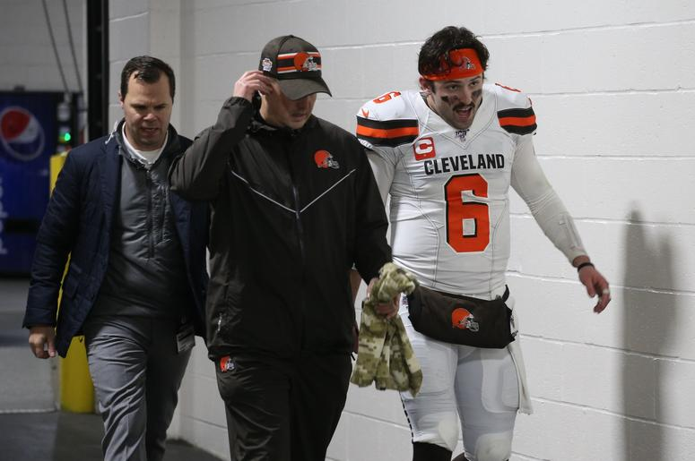 Cleveland Browns quarterback Baker Mayfield (6) returns to the locker room early after suffering an apparent injury to his hand against the Pittsburgh Steelers late in the second quarter at Heinz Field.