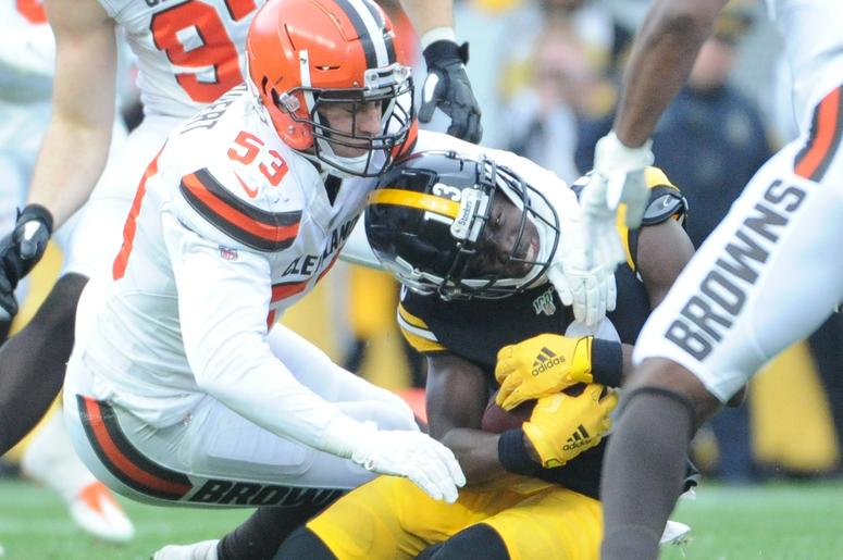Pittsburgh Steelers wide receiver James Washington (13) is stopped by Cleveland Browns linebacker Joe Schobert (53) during the second quarter at Heinz Field. The Steelers won 20-13.