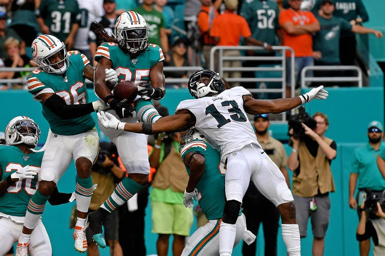 Dec 1, 2019; Miami Gardens, FL, USA; Philadelphia Eagles wide receiver Nelson Agholor (13) is unable to make a catch as Miami Dolphins free safety Adrian Colbert (36) and Miami Dolphins defensive back Walt Aikens (35) defends the play during the second ha