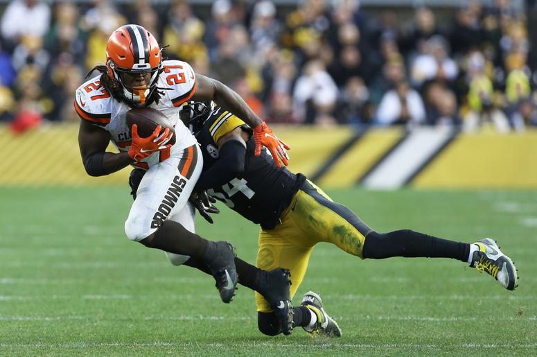 SA; Cleveland Browns running back Kareem Hunt (27) runs the ball against Pittsburgh Steelers strong safety Terrell Edmunds (34) during the fourth quarter at Heinz Field. The Steelers won 20-