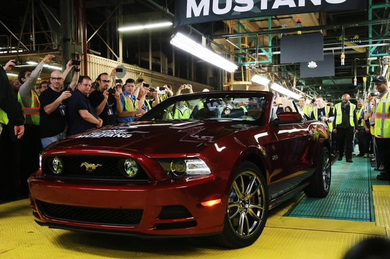 Ford Flat Rock Assembly Plant material planning and logistics manager Ed Salna and Ford group Vice President for Product Development Raj Nair pull up in a Ruby Red 2014 Mustang convertible, April 17, 2013. It's the one millionth Ford Mustang built at the