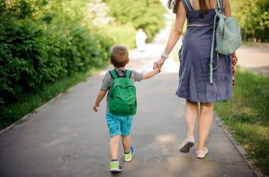 boy and mom walking
