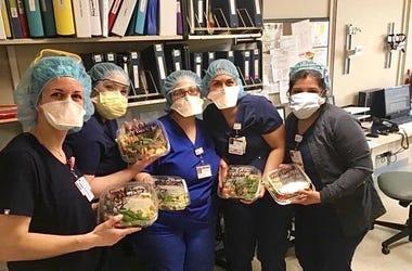 nurses holding salads