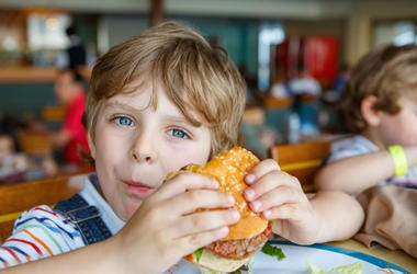 kid eating burger