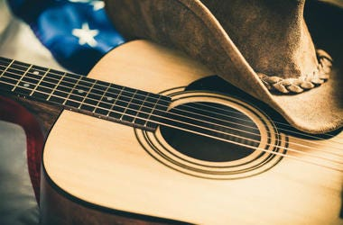 guitar cowboy hat