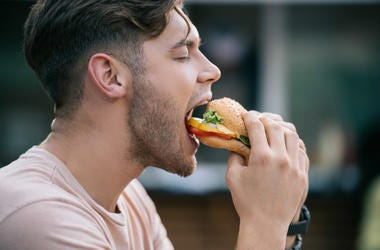 guy eating a burger