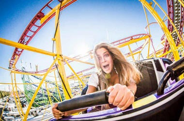 woman riding rollercoaster