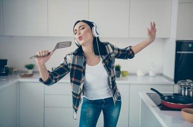 woman singing in kitchens