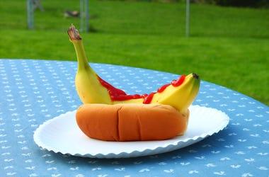 A banana dog with ketchup.