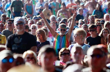 fan flashes the peace sign during the concert marking the 40th anniversary of the Woodstock music festival August 15, 2009 in Bethel, New York.