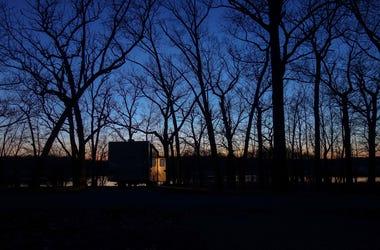 RV in woods.