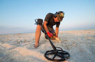 Metal detector on beach.