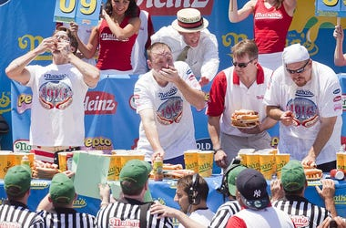 Champion Eaters Compete In Nathan's Annual Hot Dog Eating Contest