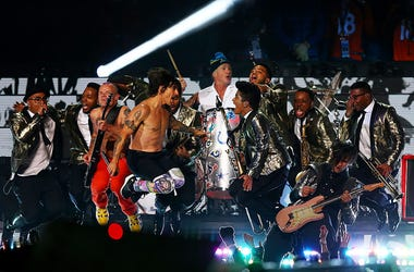 AST RUTHERFORD, NJ - FEBRUARY 02: Bruno Mars and the Red Hot Chili Peppers performB during the Pepsi Super Bowl XLVIII Halftime Show at MetLife Stadium on February 2, 2014 in East Rutherford, New Jersey.