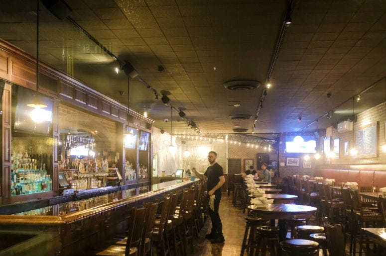 Waiters and bartenders clean up bars and restaurants along North High Street in the Short North District on March 15, 2020 in Columbus, Ohio.