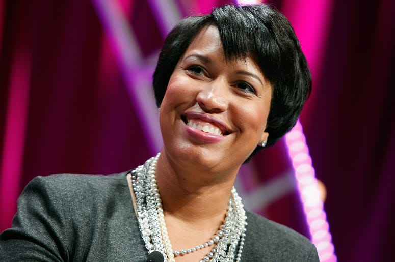 Mayor Murial Bowser poses smiling.