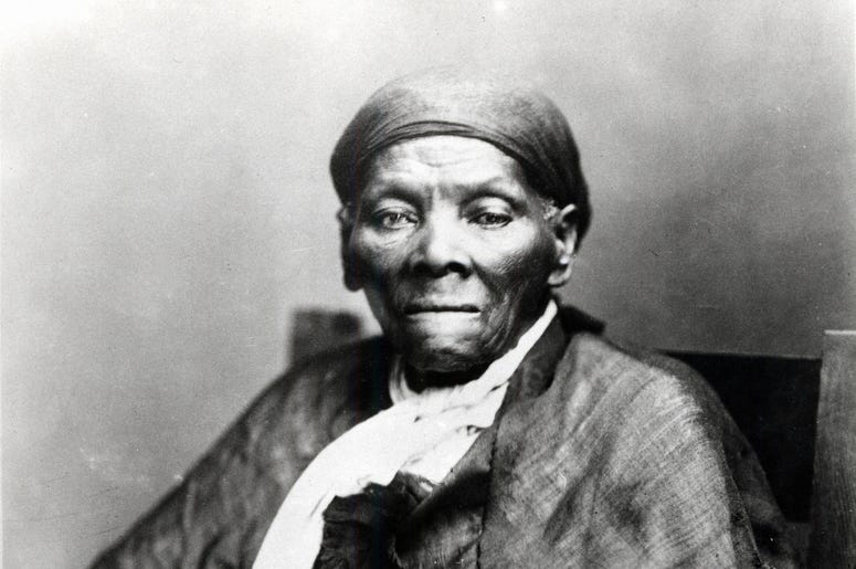 Harriet Tubman is pictured sitting in a black and white portrait.
