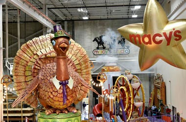 Parade floats are pictured in a Macys warehouse.
