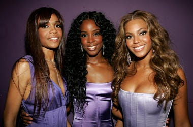 Beyoncé, Kelly and Michelle Williams pose in lavender gowns.